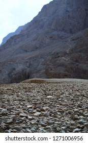 Hiking path at Qumran caves in Qumran National Park, where the dead sea scrolls were found, Judean desert hike, Israel