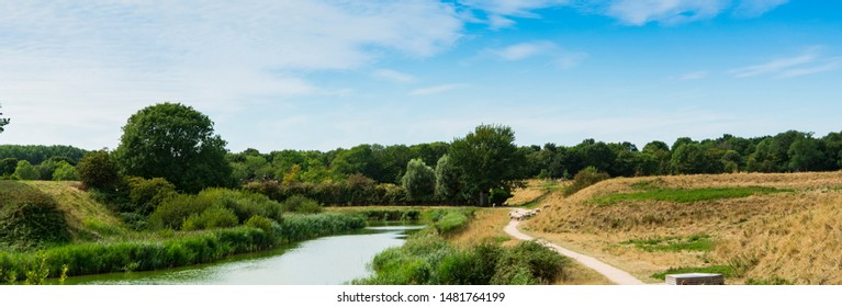 Hiking path, water, sheep and trees in Veere. The Netherlands
