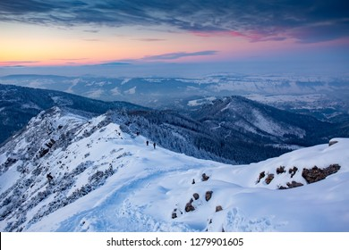Hiking people in the mountains snow winter evening in Europe.  				Kasprowy wierch, Tatra mountian, Poland