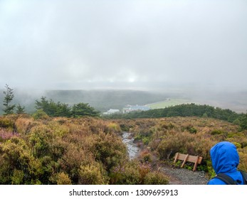 Hiking in the rain in in Tongariro park in New Zealand