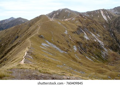 Hiking the ridge line of the alpine Kepler Track Great Walk in New Zealand with amazing valley lake views