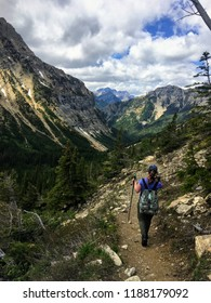 Hiking the rocky terrain of the Crypt Lake Trail, a steep ascent to Crypt Lake including walking a long the very edge of a mountain.  The hike is in Waterton Lakes National Park in Alberta, Canada