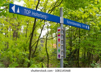 hiking routes sign and arrows in different colors in the netherlands