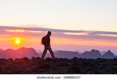 Hiking scene in beautiful summer mountains at sunset