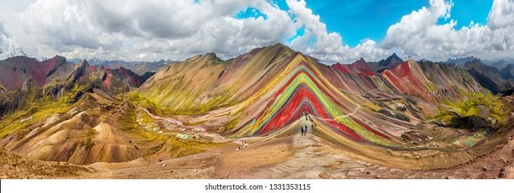 Hiking scene in Vinicunca, Cusco Region, Peru.  Rainbow Mountain (Montana de Siete Colores).