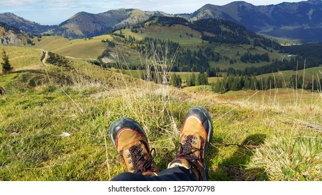 hiking shoes in front of bavarian mountains, allgau