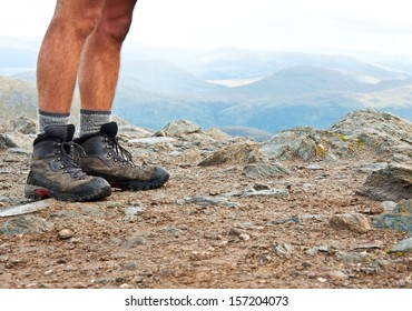 Hiking shoes on the summit from hike walk in Scotland