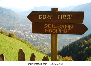 Hiking sign at the Meran High Alpine Tour (German: Meraner Hoehenweg, Ital.: Alta via di Merano). Two directions: the village Tirol and the cableway station Hochmuth