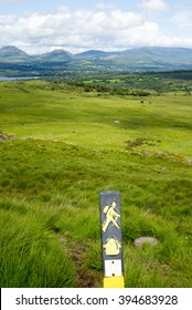 hiking signpost with mountain view from the kerry way walk in ireland