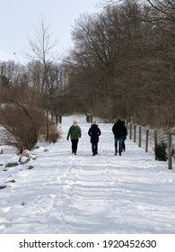 Hiking in a snow covered park with rivers and wooden fence in Ohio USA