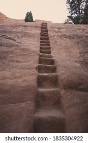 Hiking steps carved into a staircase in a steep rock, in Red Rocks open space in Colorado Springs