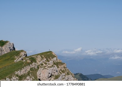 Hiking summit in the early morning in the Dolomite Mountain Range in the Italien Alps