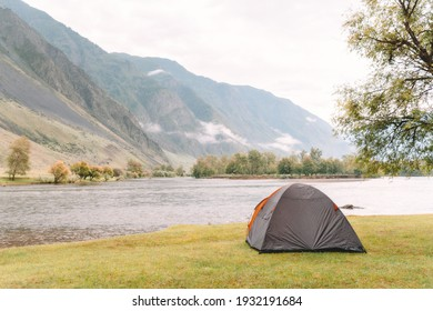 hiking tent on the beach of river