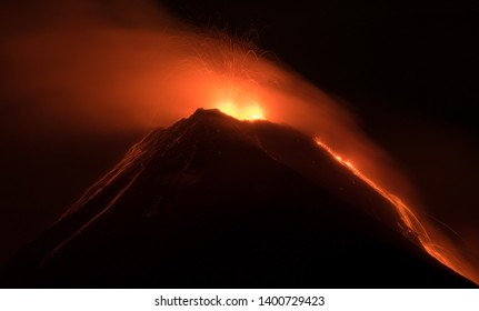 Hiking at the top of Acatenango in Guatemala to admire volcano Fuego erupting and spitting lava all night long.