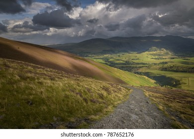Hiking to the top of skiddaw mountain Lake District England view on Keswick valley with beutiful sunlight