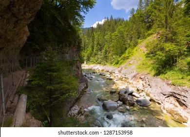 Hiking trail along Kaiserklamm canyon, Kaiser Gorge, beautiful narrow valley between rocky walls at Kaiserklamm in Brandenberg, Kramsach, Tyrol, Austria