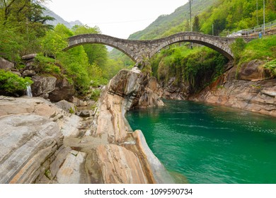 hiking Trail at the famous Roman Bridge called Ponte dei Salti in Lavertezzo,Verzasca Valley,Ticino Canton,Switzerland
