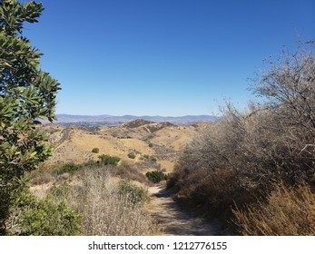 Hiking trail leading through the hills above the suburbs, California