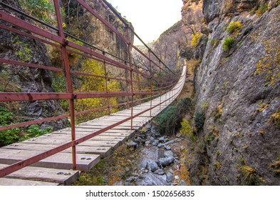 Hiking trail Los Cahorros de Monachil (Granada) in Autumn. Impressive gorge carved by the Monachil River. It is a place of singular beauty with waterfalls, caves and suspension bridges.