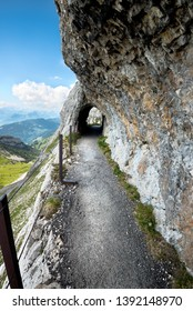 Hiking trail moving through a tunnel on Pilatus Switzerland