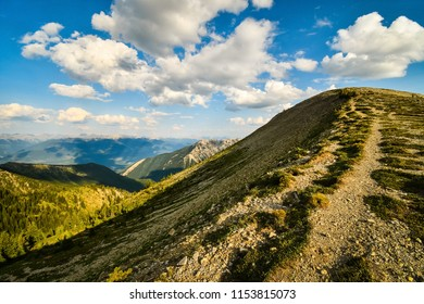 Hiking trail on a mountain summit in the Rocky Mountains