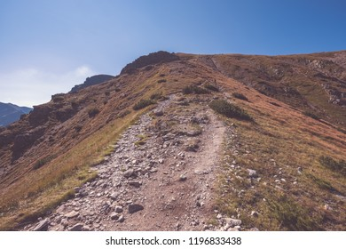 hiking trail on top of the mountain. Tatra, Slovakia. Western carpathian mountains in early autumn colors with clean air. Tourist track - vintage retro look - vintage color look
