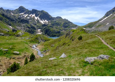 Hiking trail, peak and stream in the french Pyrenees near Aston in Ariege