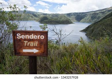 hiking trail sign at Cuicocha Lagoon in Ecuador