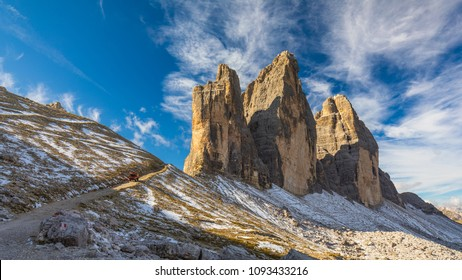 Hiking Trail in Tre Cime di Laveredo. Lake. Meadow. Green Grass. Summer. Blue Sky. Mountain Peak. Dolomites. Italy. Tre cime are one of the best-known mountain groups in the European Alps