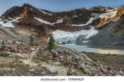 The Hiking Trail to Upper Lyman Lake, Lyman Glacier, and Red Mountain Wake in the Morning with Early Dawn Light
