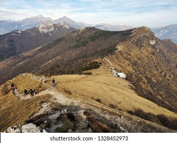 Hiking trails in the Italian Alps with a mountain lodge and a tv tower in the background