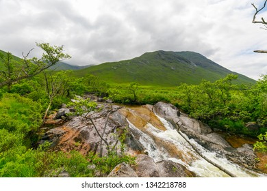 Hiking trip to Loch Etive on cloudy day in summer