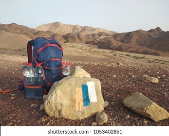 hiking ultralight through Negev Desert in Israel demands big quantity of water. Backpack of experienced hiker on Israel National Trail on first day of it.