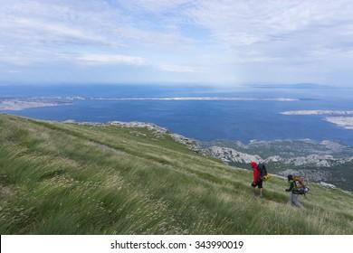 Hiking Velebit mountain range, Croatia. Adriatic islands in background.