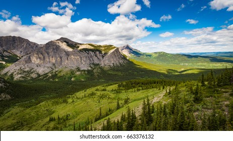 Hiking views from Mount John Laurie (Yamnuska), overlooking the foothills and prairies of Alberta Canada