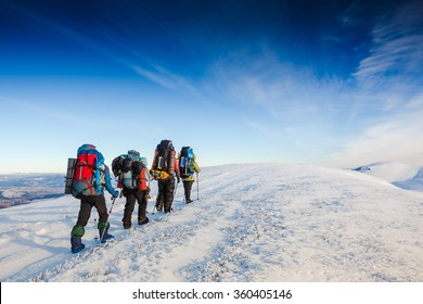 hiking in winter mountains. People traveling and sport concept