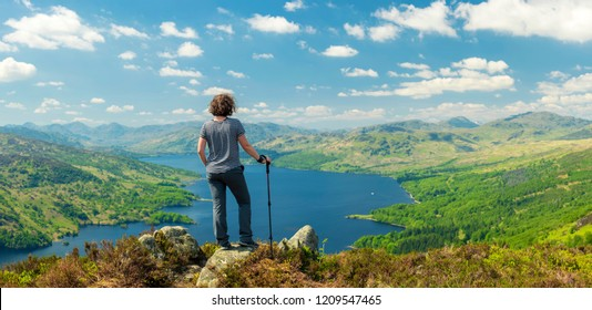 Hiking woman on top of the Mountain in Ben A'an Hill, Highlands, Scotland, Panoramic Shot - Panorama Of Landscape View From Ben A'an Hill, Highlands, Scotland