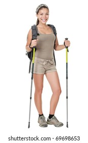 Hiking woman standing isolated. Female hiker with backpacking bag and hiking poles / walking sticks isolated on white background in full length.