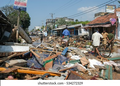 Hikkaduwa, Sri Lanka - 26 December 2004: people walking on the debris after the tsunami at Hikkaduwa in Sri Lanka