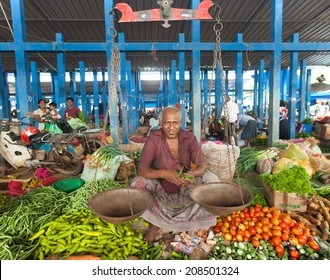 HIKKADUWA, SRI LANKA - FEBRUARY 23, 2014: Portrait of market vendor selling produce. The Sunday market is great way to see Hikkaduwa's local life come alive along with fresh produce and local delicacy