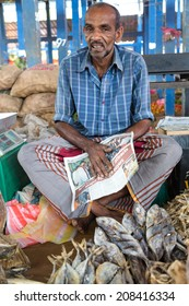 HIKKADUWA, SRI LANKA - MARCH 9, 2014: Local street vendor selling fish. The Sunday market is a fantastic way to see Hikkaduwa's local life come alive along with fresh produce and local delicacy.