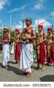HIKKADUWA, SRI LANKA - SEPTEMBER 08, 2013 : Sword Carriers march along the coastal road during the Buddhist perahera (procession).