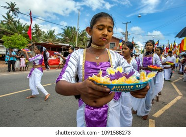 HIKKADUWA, SRI LANKA - SEPTEMBER 08, 2013 : Sri Lankan girls perform along the beach road at Hikkaduwa during a Buddhist perahera (procession).