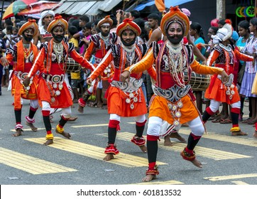 HIKKADUWA, SRI LANKA - SEPTEMBER 8, 2013 : Colourfully dressed dancers perform during the Hikkaduwa Perahera. The perahera is held to honour the sacred tooth relic of Lord Buddha.