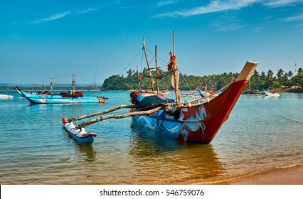HIKKADUWA,SRI LANKA/JANUARY 27,2016:The traditional boat of Sri Lankan fishermen