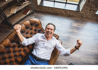 Hilarious businessman laughing with joy