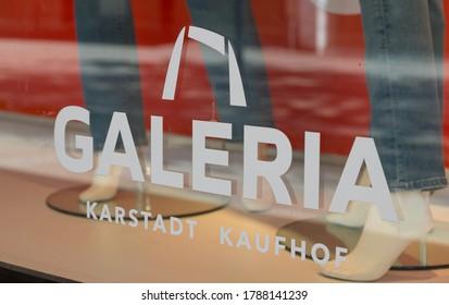 Hildesheim, Germany - July 29, 2020: Logo and inscription of German department store Galeria Kaufhof Karstadt on a shop window