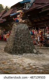 Hilimondregeraya traditional village, South Nias, North Sumatra, Indonesia - September 17, 2016 : Traditional stone (wall) jumping in the traditional village Hilimondregeraya