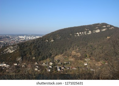 A hill with Avanne in the foreground and  Besançon in the background in Franche Comté, France