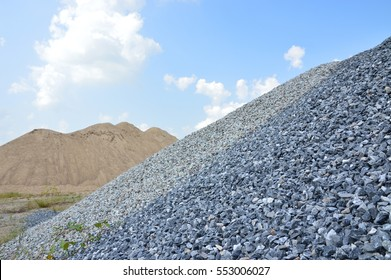 Hill of fine and coarse aggregate to the blue sky. sand and rock for construction